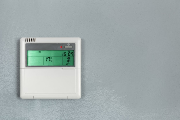 Air conditioner control, thermostat digital programmable on wall