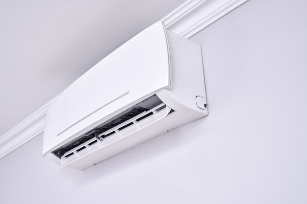 Air conditioner isolated on white wall indoors close up
