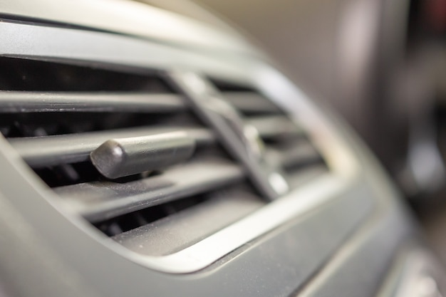 Air conditioner in modern compact car close up