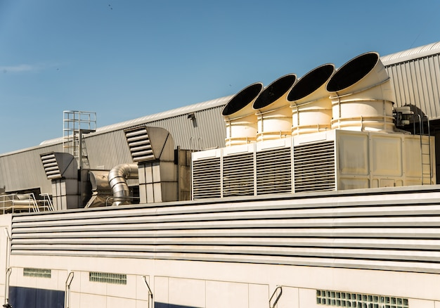 Air conditioner on the roof with blue sky