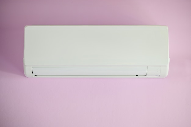 Air conditioner, wall hanging white, purple color on wall in bedroom