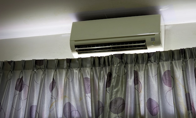 Air conditioner on wall in room