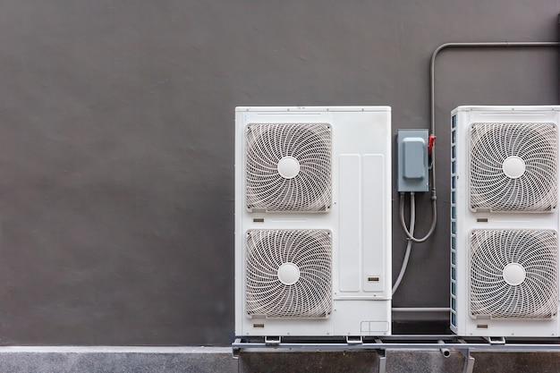 Air conditioning compressor installation on pedestal.
