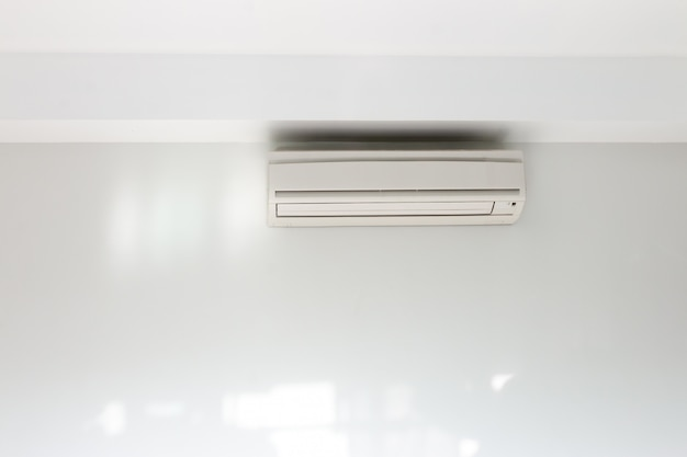 Air conditioning installed on a white concrete wall in the house