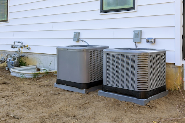 Air conditioning repair system model is actual electrician on a compressor refueling the air conditioner with freon