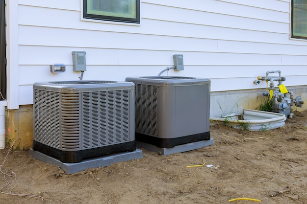 Air conditioning system unit installed outside facade of the new house