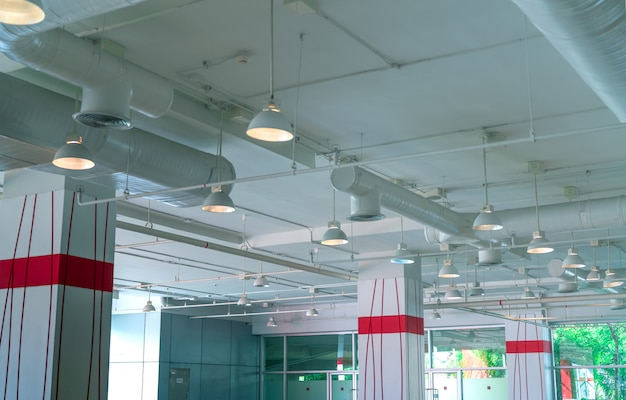 Air duct, air conditioner pipe, fire sprinkler system. air flow and ventilation system. building interior. ceiling lamp light with opened light. interior architecture.