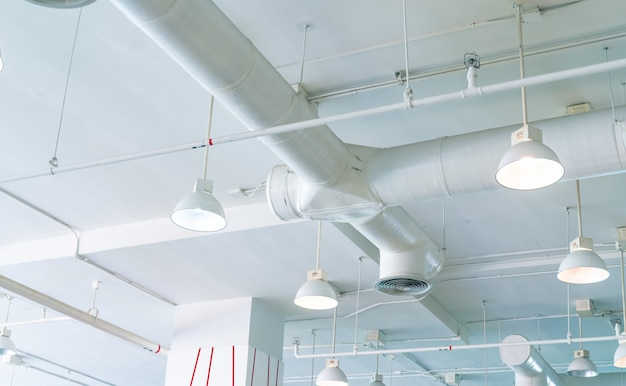 Air duct, automatic fire sprinkler safety system. fire protection and detector. fire sprinkler system. building interior concept. ceiling lamp light with opened light.