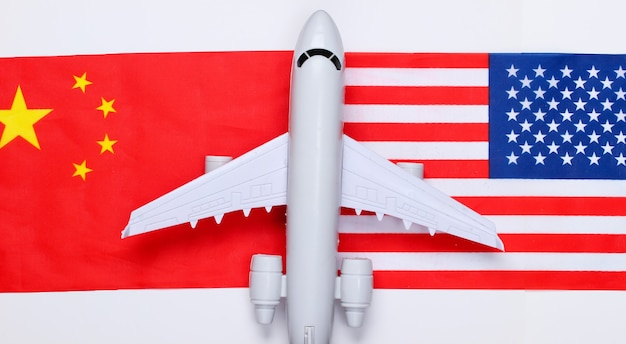 Air flight between countries. figurine of airplane with the flag of china and the usa. air travel
