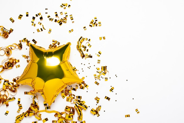 Air golden balloons star and confetti shape on a white background.