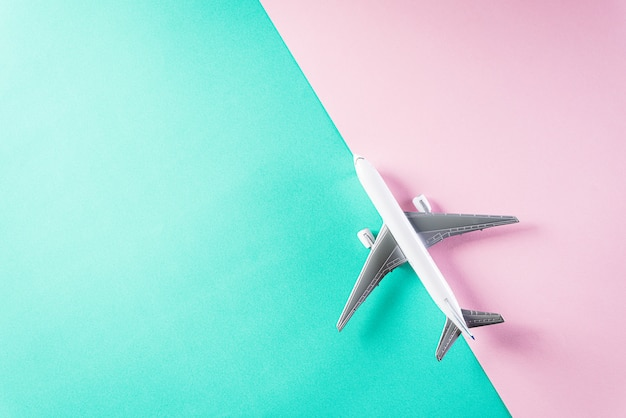 Air plane on pastel wall foe travel concept