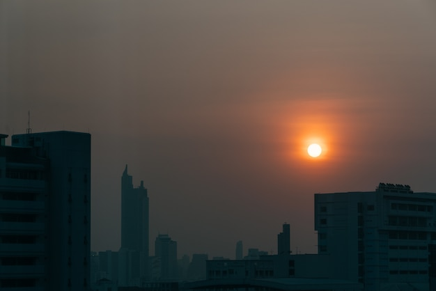 Air pollution effect made low visibility cityscape with haze and fog from dust in the air.