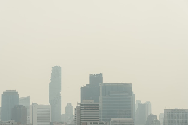 Air pollution effect made low visibility cityscape with haze and fog from dust in bangkok, thailand.