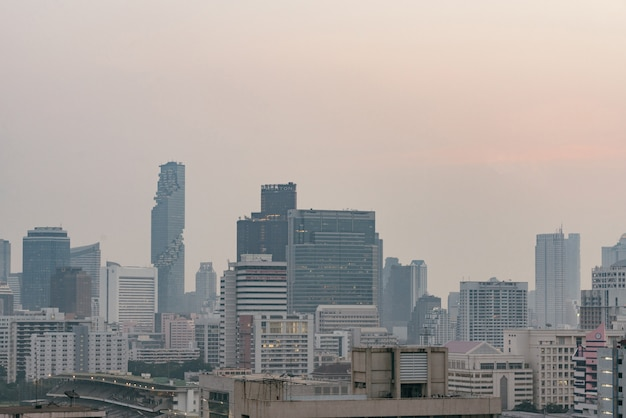 Air pollution effect made low visibility cityscape with haze and fog from dust.