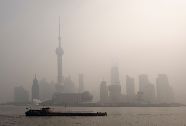 Air pollution over shanghai, a barge is passing