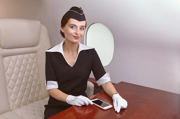 Air steward in passenger cabin inside plane.