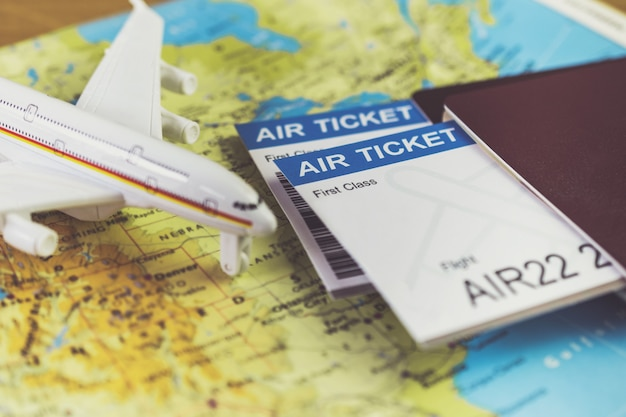 Air ticket and passports on the map, flight to america, travel concept
