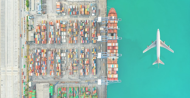 Air transportation and transit of container ships loading and unloading in hutchison ports, business logistic import-export transport sea freight