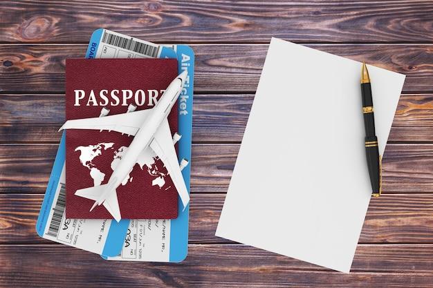 항공 여행 개념입니다. 제트 여객기, 여권, 티켓, 빈 종이, 펜이 나무 탁자 위에 있습니다. 3d 렌더링.