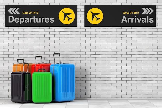 空の旅のコンセプト。レンガの壁の前にある空港の出発と到着の情報パネルの近くにある大きなマルチカラーのポリカーボネート製スーツケース。 3dレンダリング