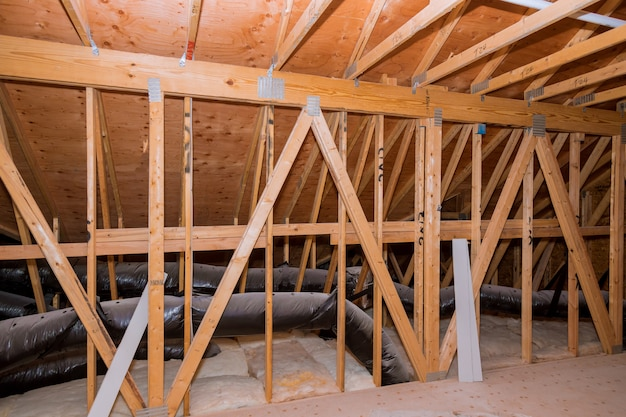 Air ventilation pipes in silver insulation material on the attic
