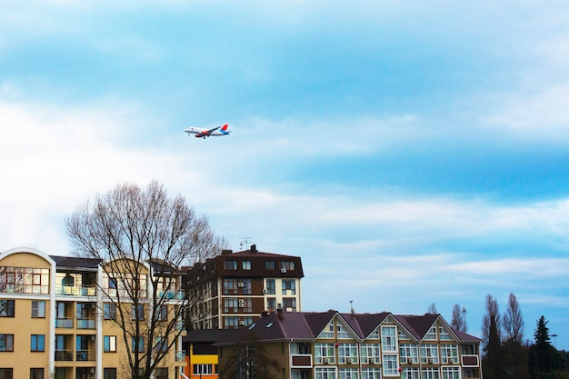 Airbus flies over the roofs of houses