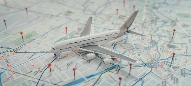 세계 지도의 경로에 핀으로 항공기 및 위치 표시. 모험, 발견, 통신, 물류, 운송 및 여행 테마 개념 배경. 3d renderin 및 illusrration입니다.