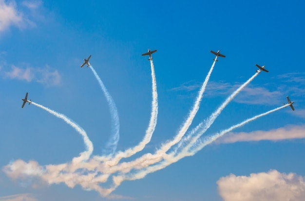 Aircraft fighter jets smoke the background of sky clouds.