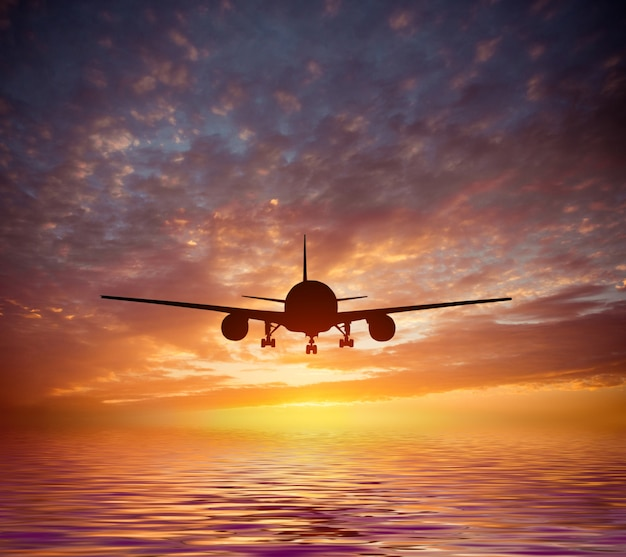 Aircraft flies over the ocean