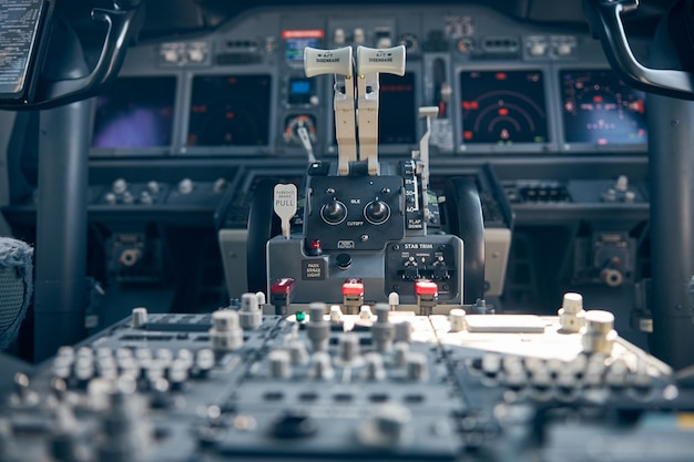 Aircraft flight deck with thrust levers or power levers on pedestal instrument panel