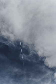 Aircraft flying across the cloudy sky