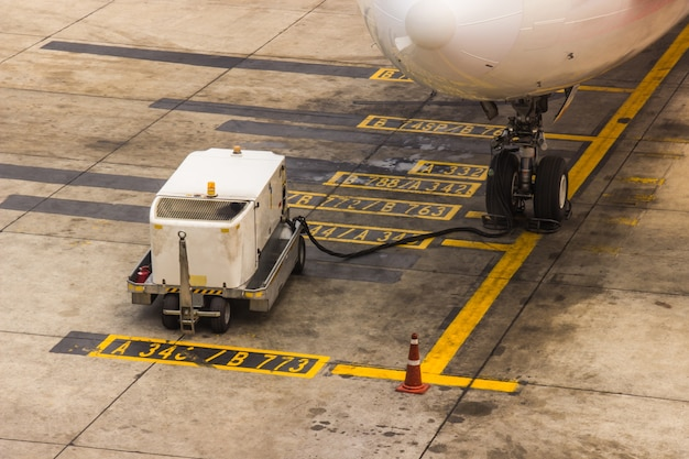 Aircraft maintenance main gear checking in the airport before departure for safety