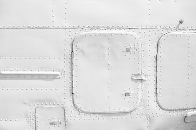 Aircraft metal plating texture with rivets