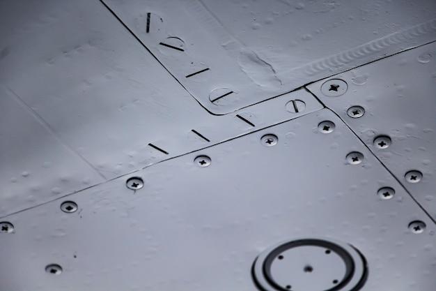 Aircraft skin close up. rivets on gray metal. aluminum texture