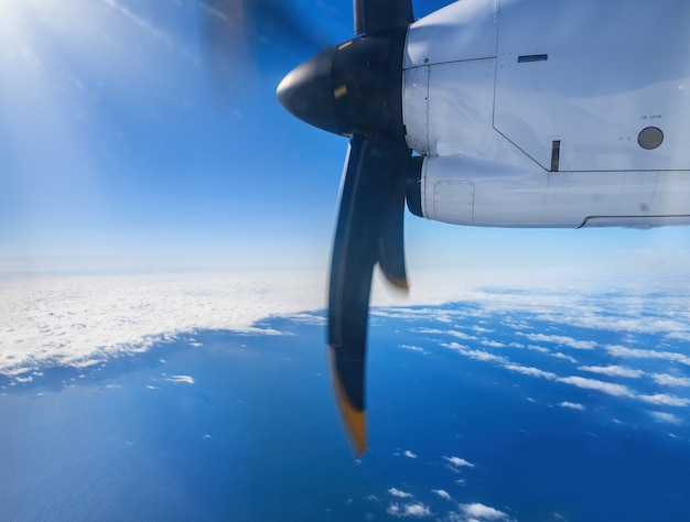 Aircraft turboprop engine view from the window during flight