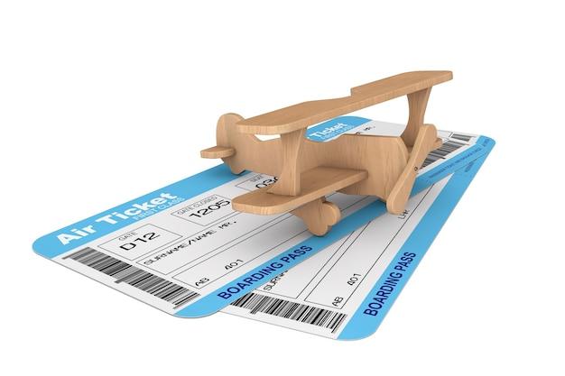 白い背景の上のおもちゃの飛行機で航空会社の搭乗券チケット