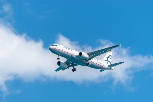 Airplane aegean airlines on blue sky