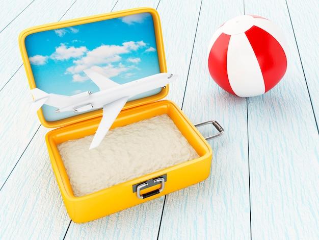 Самолет, пляжный мяч и чемодан с песком.