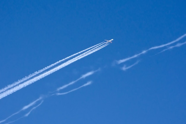 Airplane big four engines aviation airport contrail clouds.