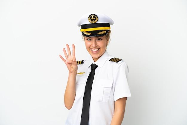 비행기 금발 여자 조종사 흰색 배경에 행복 하 고 손가락으로 4를 계산에 고립