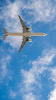 Airplane on blue sky, wallpaper for mobile phone