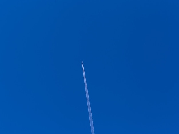 Airplane in the blue sky