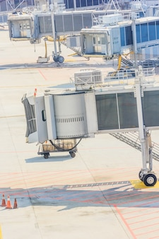 Airplane bridge in airport for passengers boarding or jetway waiting for a plane to arrive