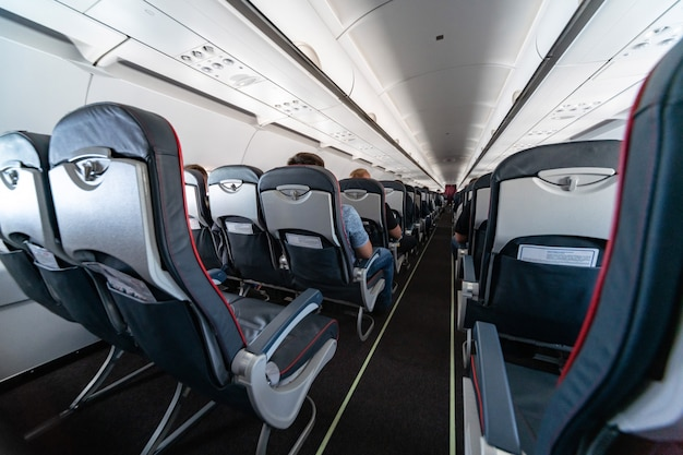 Airplane cabin seats with passengers