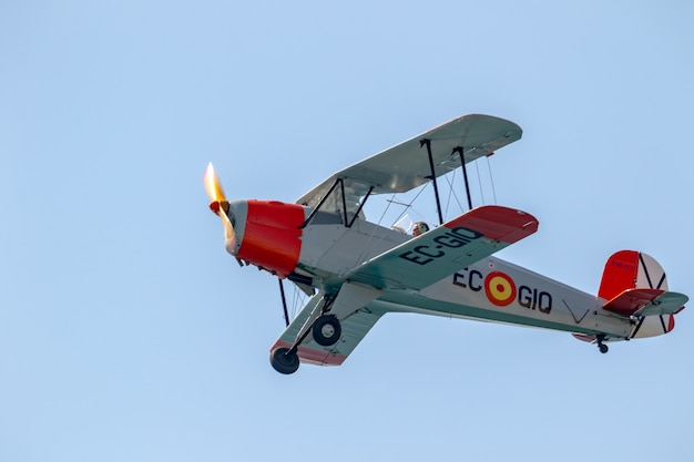 Airplane casa bucker 1.131e jungmann taking part in a exhibition on the 2nd airshow of torre del mar