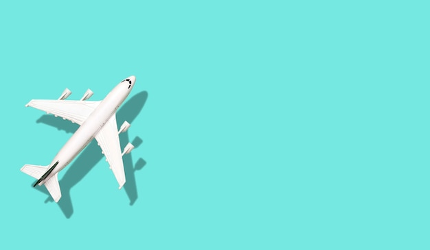 Airplane on a colored blank banner background. Premium Photo