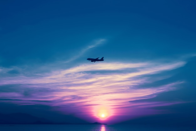 Airplane on the colorful sky