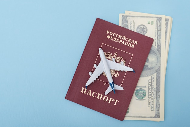 Airplane on the cover of a russian passport. dollars. travel . blue