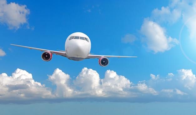Airplane flies from summer sky cumulus clouds.
