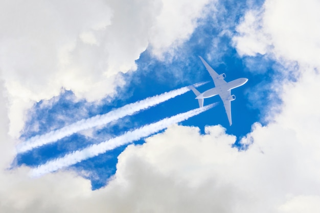 Airplane flies high in the sky, a journey through the clouds.